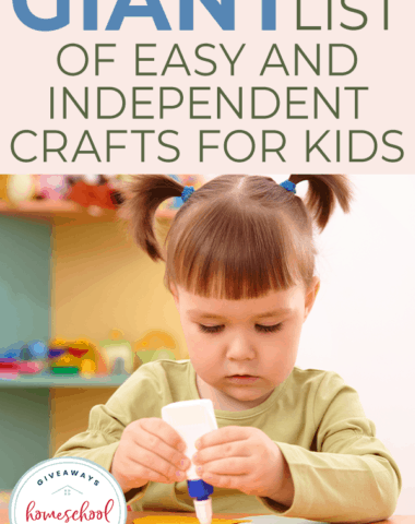 young girl gluing and crafting with paper