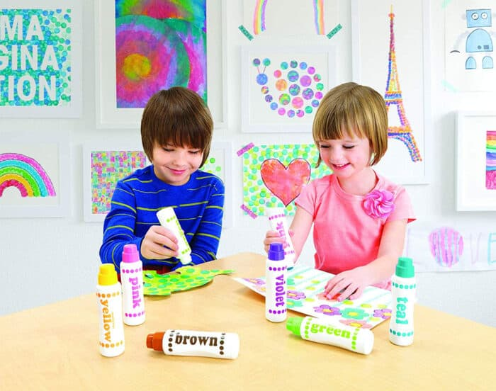 kids playing with do a dot markers