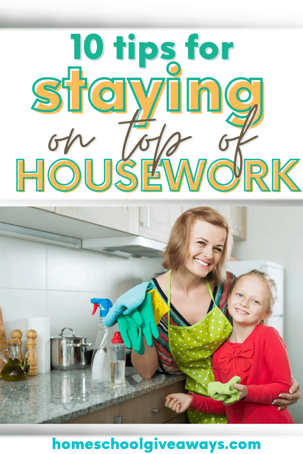Mom and daughter with cleaning spray and rubber gloves in a kitchen