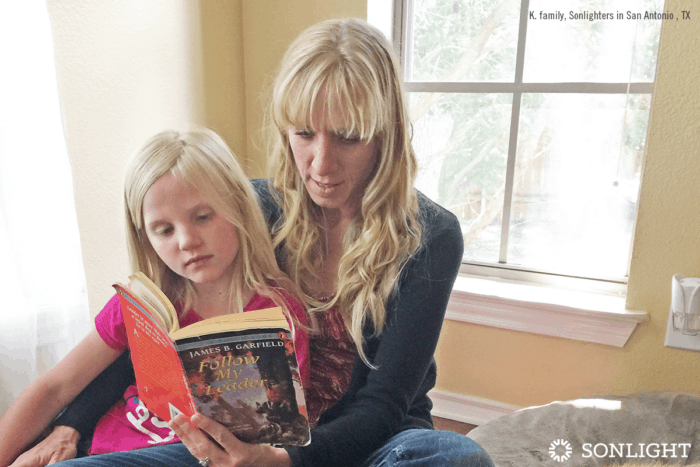 mom reads to daughter